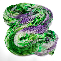 A gray, purple, and white skein of yarn