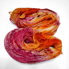 A pink, orange, and white skein of yarn.