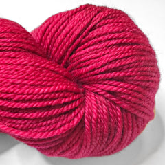 A closeup of a bright red skein of yarn