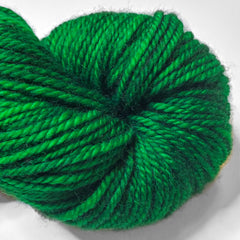 A closeup of a green skein of yarn