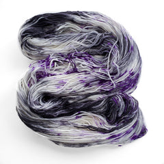 A grey, black, purple, and white skein of yarn