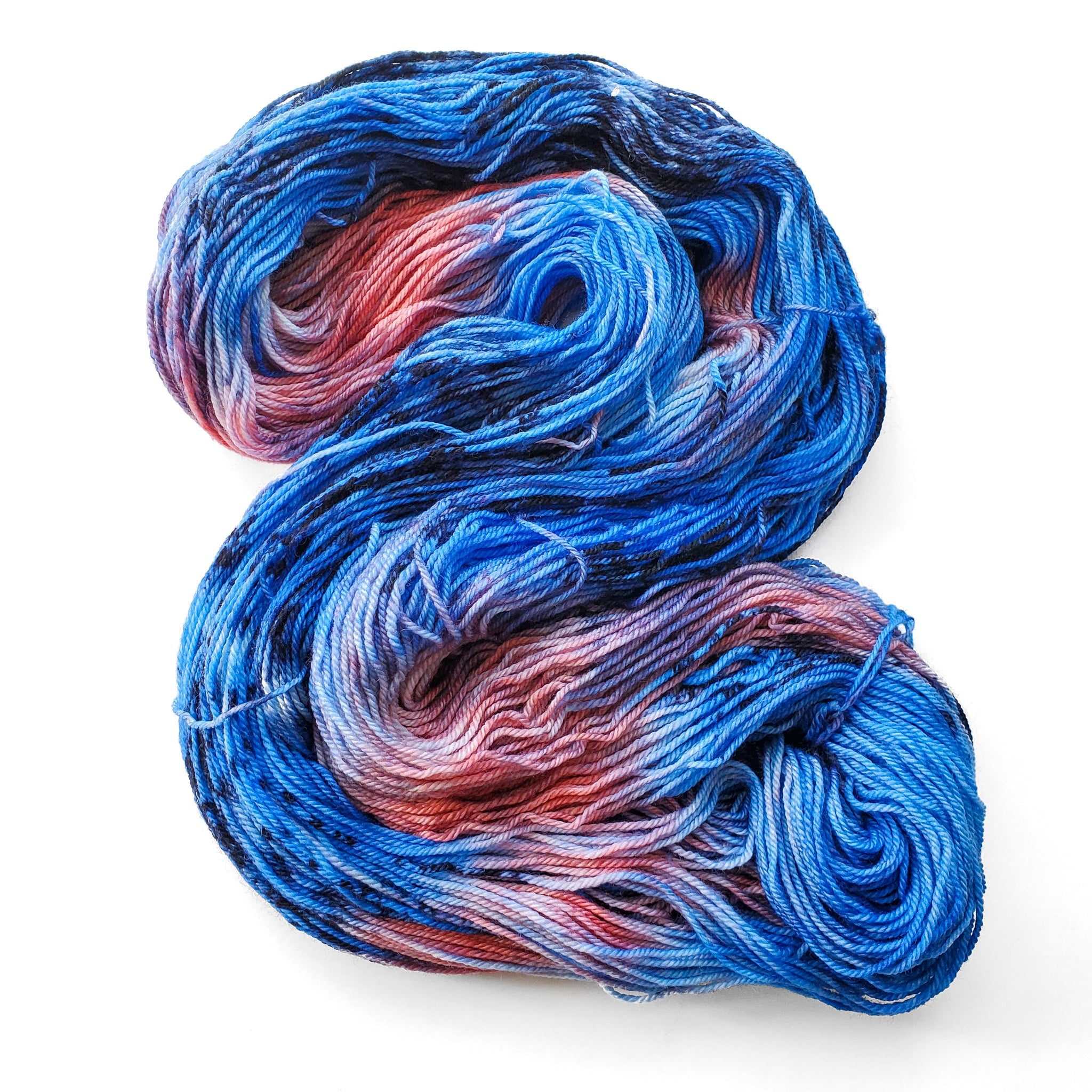 a bright blue and pink skein with dark blue speckles
