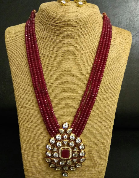 Kundan Pendant and strings of Red bead Necklace with Earrings Set