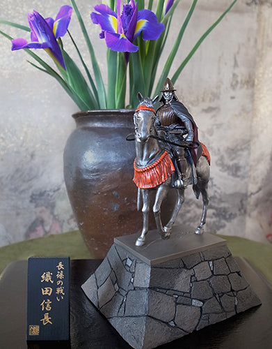 Warlord Oda Nobunaga's statue on horse being displayed with flowers.