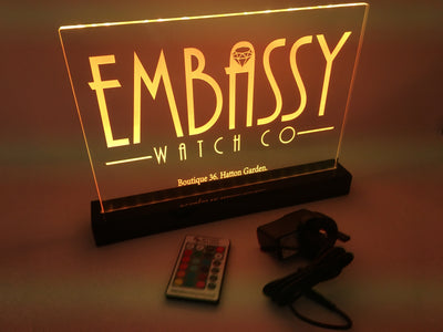 Custom engraved edge lit acrylic display stand.