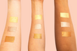 image of swatches of rose, bubbly & cognac on forearms of light, medium and deep complexions against peach background