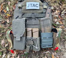 Load image into Gallery viewer, J Tactical Solutions tuckable tourniquet pouch puts tq's where they can be reached if arm immobilized