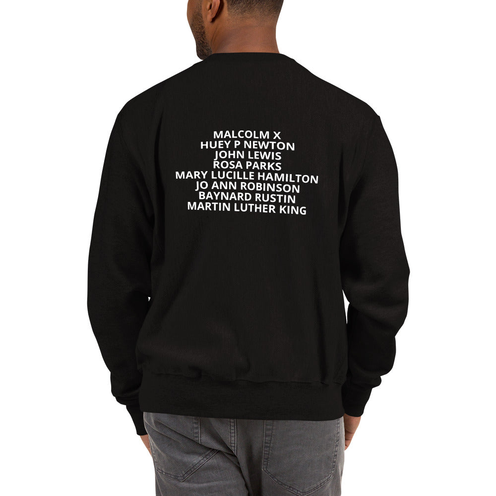 The back of Man wearing a black sweater with the names of civil rights hero's on it the names are Malcolm X, Huey P Newton, John Lewis, Rosa Parks, Mary Lucille Hamilton, Jo Ann Robinson, Baynard Rustin, Martin Luther King