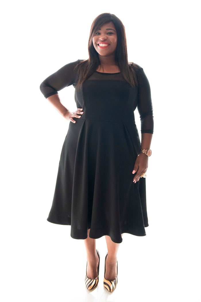 curvy lady wearing our black cherry girl dress