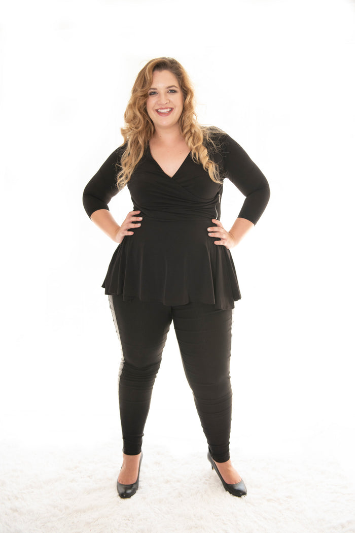 plus size model posing in our black carriere top
