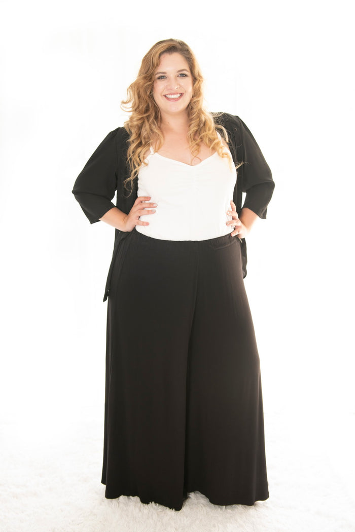 plus size lady in our black avon palazzo pants