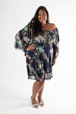 side view of navy floral sophia midi dress