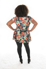 back view of model wearing our tropica print carriere top with cap sleeve