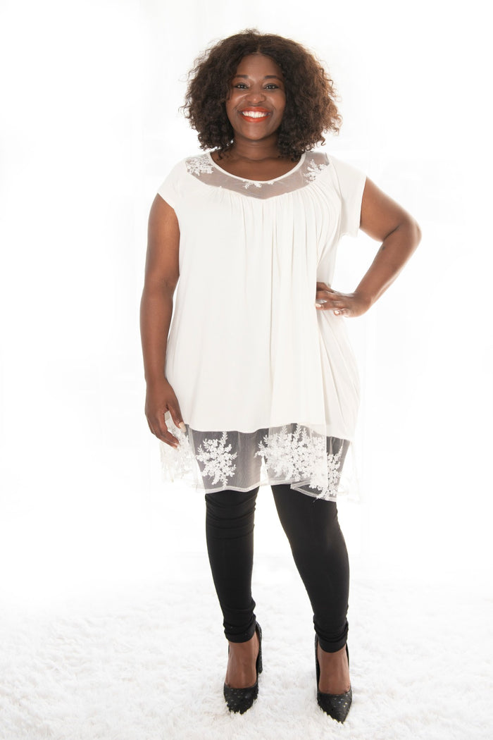 plus-size model wearing our winter white annabelle top
