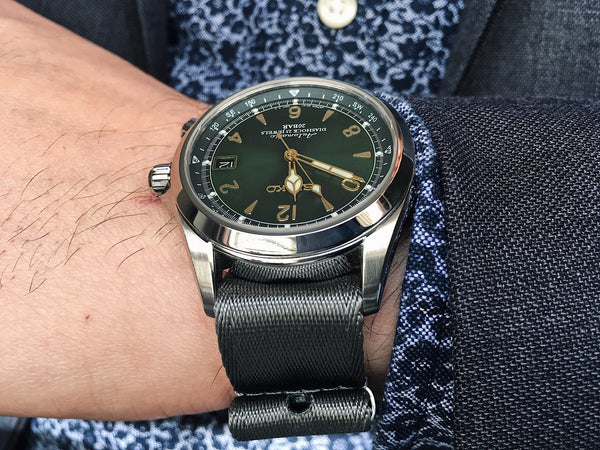 Grey NATO strap with a suit on Seiko Alpinist