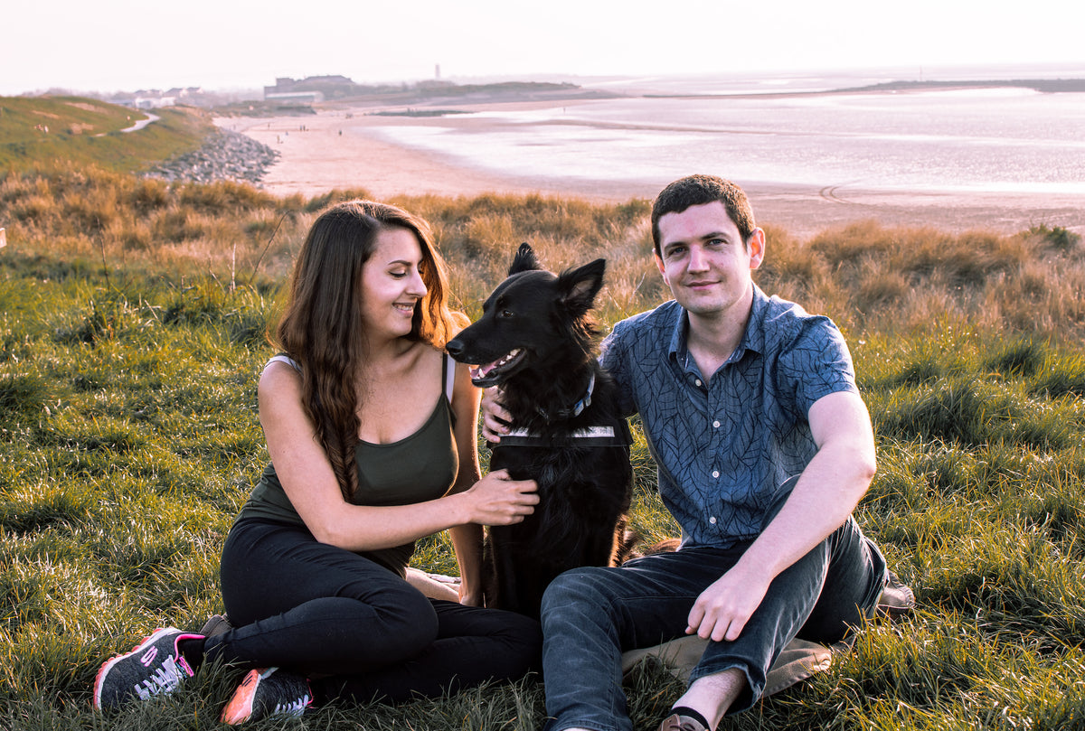 Yuggen-be-the-change-founders-sitting-on-the-beach-with-their-dog