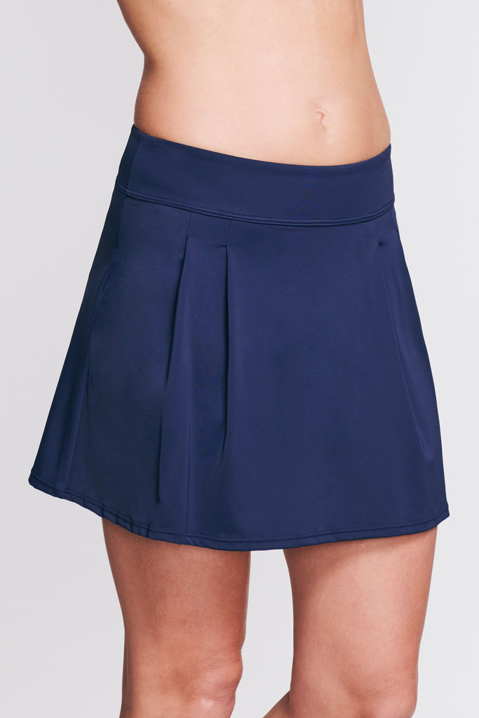 PLEATED LONG LENGTH SWIM SKIRT IN SOLID NAVY BY MAZU SWIM