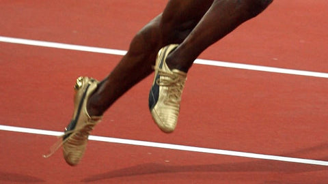 Usain Bolt running with untied shoelaces