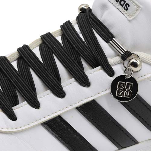 Black E3 Lachet Lastic Lace with tag in white Addidas sneaker, no tie shoe lace
