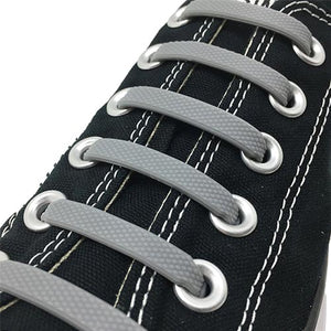 Grey E3 Silicone laces in black sneaker, no tie lace