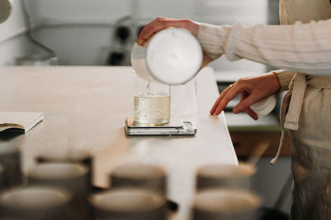 Pouring out lavender essential oils in Cedar's  candle making studio in Ancoats, Manchester.