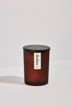 Load image into Gallery viewer, Helios essential oil candle. The natural candle is in a frosted amber container with a wooden lid and the Cedar logo at the bottom.