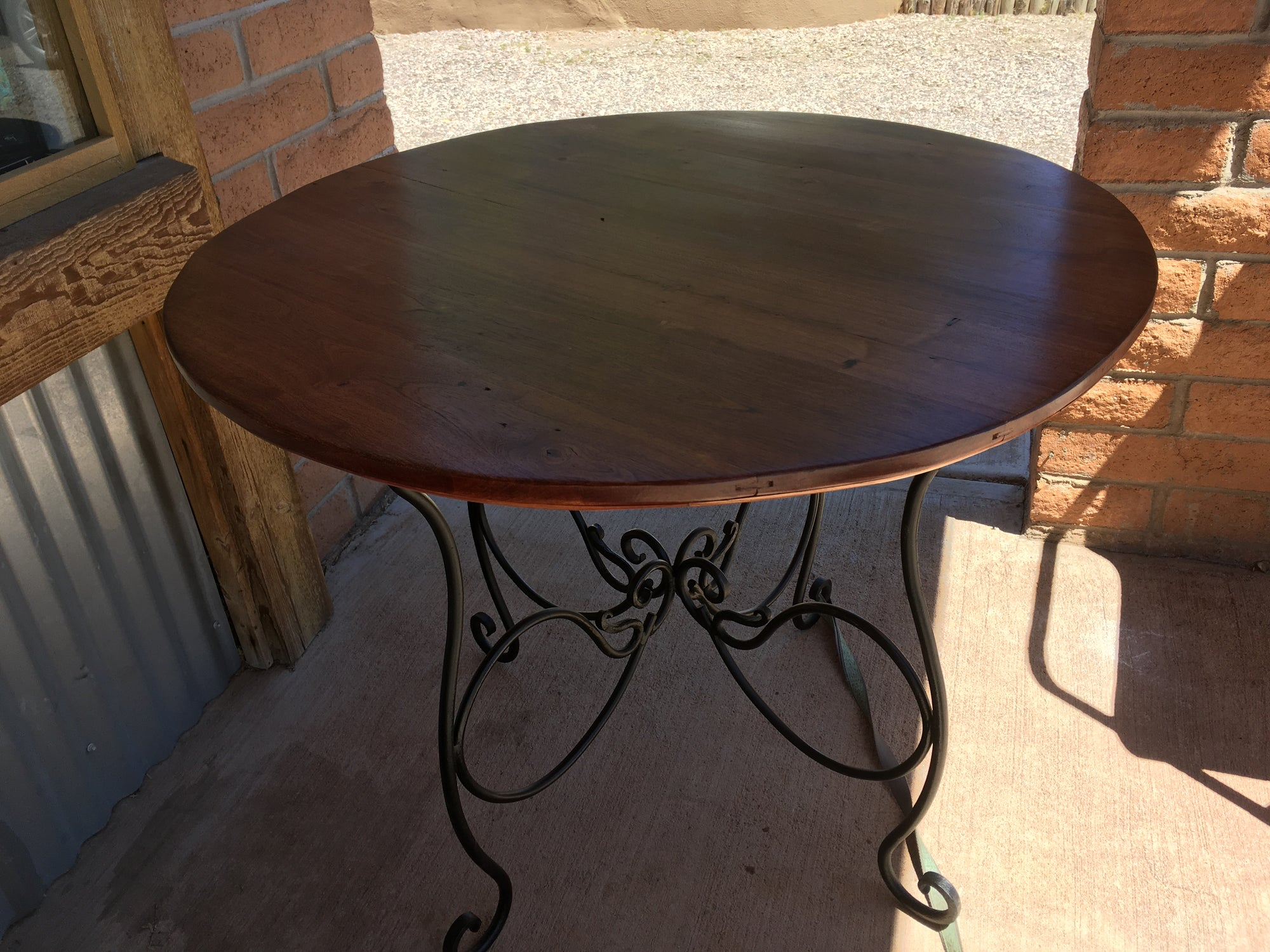 Circle Wood Table with Metal Stand Frame Available at Arroyo Framing in Tubac Arizona