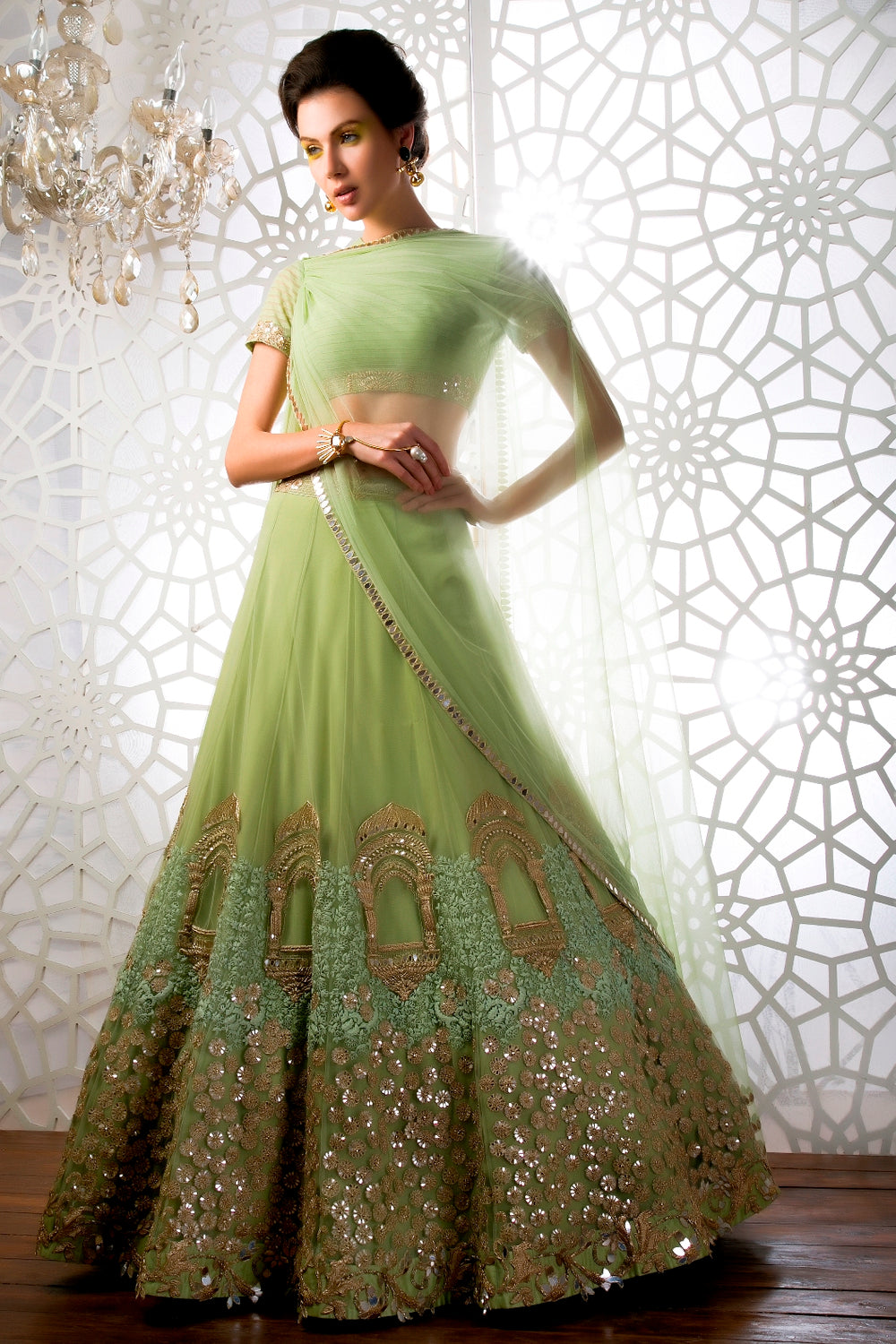 This Olive Green Lehenga Choli is featured in net fabric.