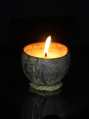 Coco Candle Co - small natural coconut shell soy candle burning at night