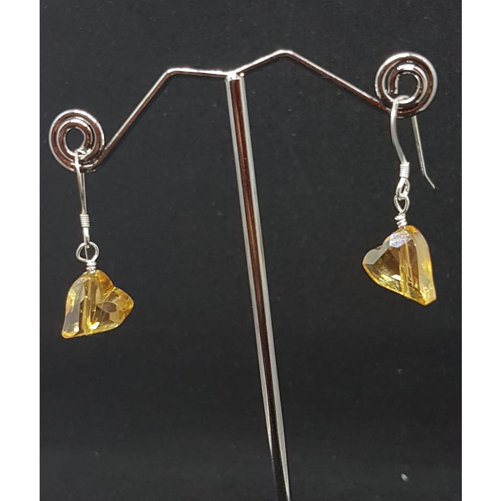 Golden hearts on silver earrings - Earrings