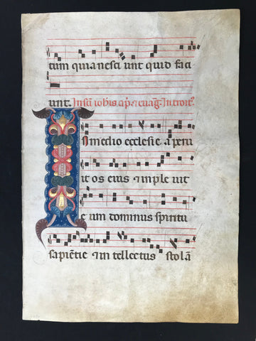 "Ornamental Initial ""I"":  Individual sheet from a liturgical manuscript - antiphonary - on parchment.  Bologna, 1320-40  Writing in red and sepia brown / black  Music notation in brown / black sepia  Leaf of a large choir book with a magnificent ""I""-initialmarking the beginning of the Introitus of St. John Apostle. The ornate, tall initial ""I"" sits on a blue field with white tracery."