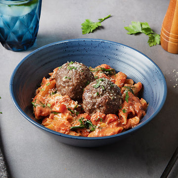 Grass-Fed Bison Meatballs with Creamy Tomato Fresca Pasta