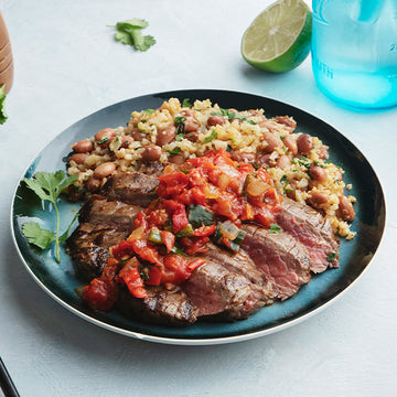 Grass-Fed Flank Steak with Roasted Chili Salsa and Cauliflower Rice and Beans