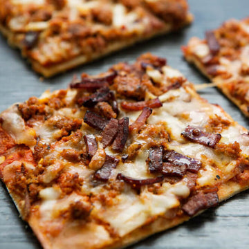 Peppered Turkey Bacon and Italian Sausage Breakfast Pizza