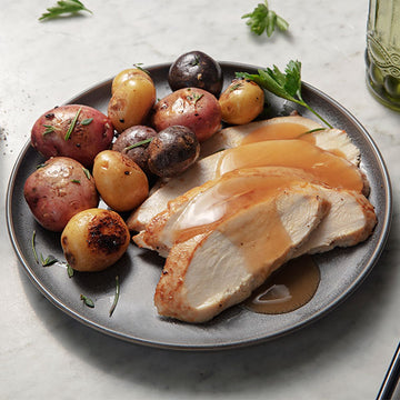 Oven Roasted Turkey with Sherry Wine Sauce and Herb Roasted Tri-Color Potatoes