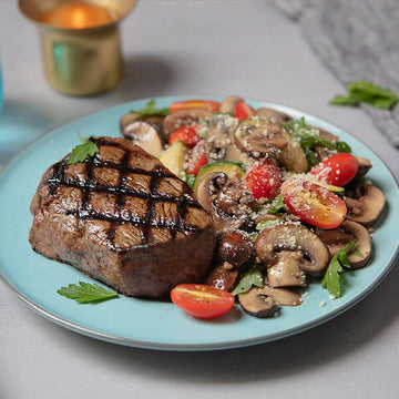 Grilled Grass-Fed Top Steak with Chardonnay Sauteed Summer Vegetables