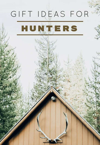 gift ideas for hunters with cabin and antlers in snowy hunting area