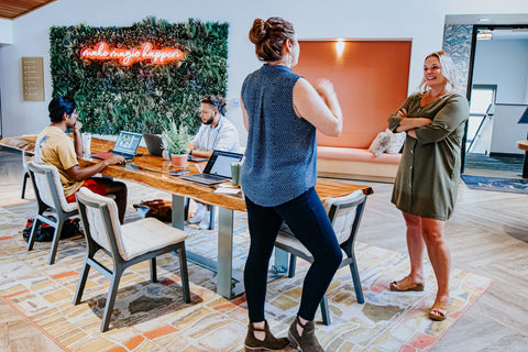 A woman speaks to another member in a coworking space in Bend Oregon