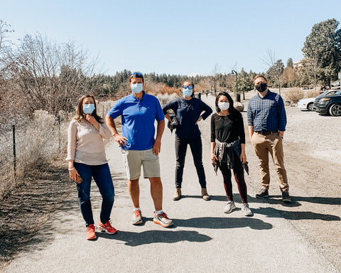 group of friends walk the river trail near Haven Coworking in Bend Oregon