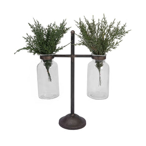 Industrial glass vases in stand