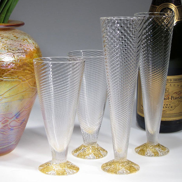 Clear and gold flutes and wine cups