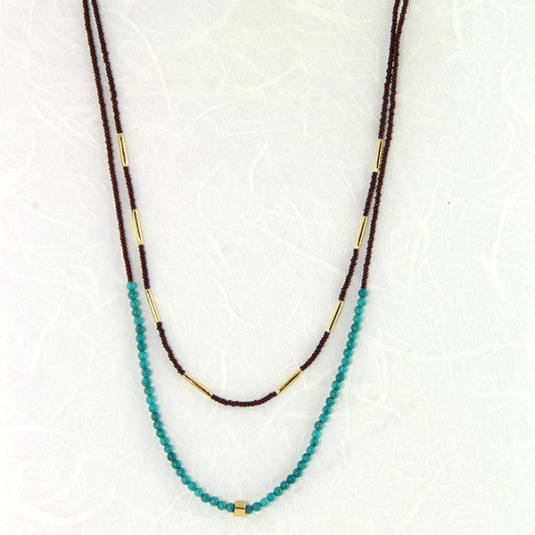 Dark brown seed with turquoise and gold vermeil