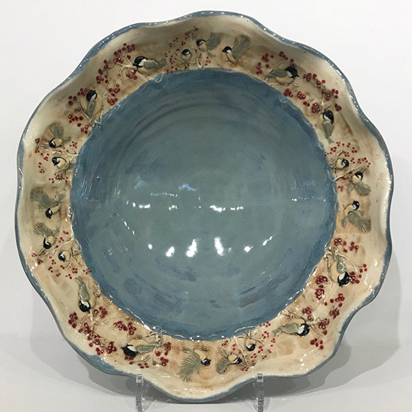 Large bowl with blue glaze and chickadees/ wavy rim