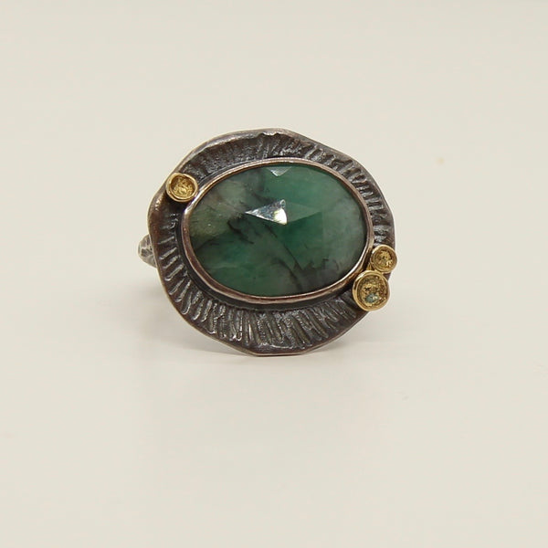 Lotus Bezel Ring with Faceted Emerald