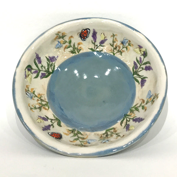 Small bowl with blue glaze and butterflies
