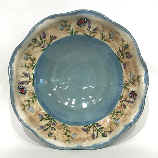 Medium bowl with blue glaze and butterflies, wavy edge