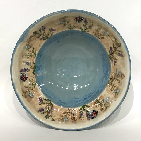 Medium bowl with blue glaze and butterflies