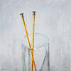 Painting of knitting needles in a glass
