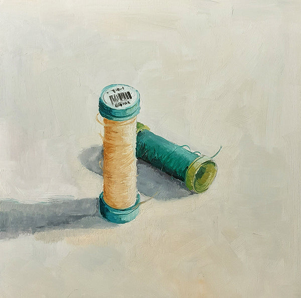 painting of two spools of thread