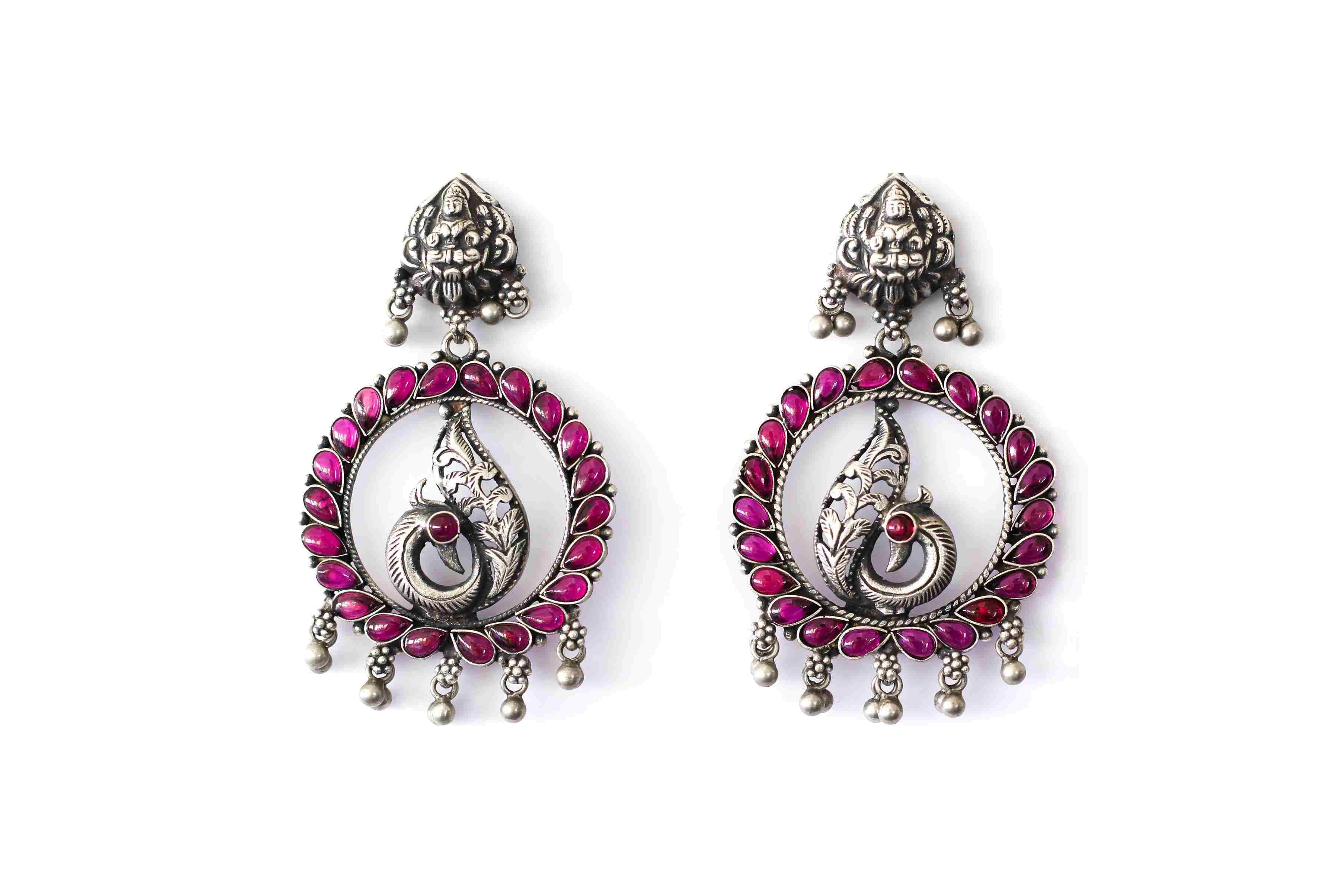 Embossed earing traditional peacock design